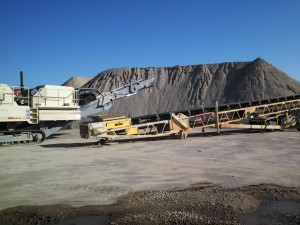 Old tarmac and pavement is being recycled on site to make base for new roads.